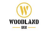 Logo Woodland Inn, Kitzingen